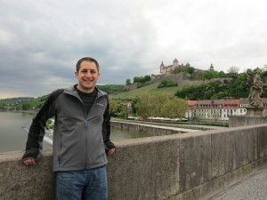 Justin on a bridge in Wurzburg with the Marienberg Fortress in the background