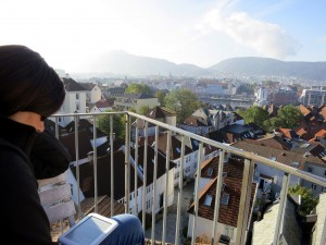 Katie reading with a view of Bergen