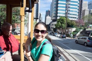 Katie riding the trolley through San Francisco