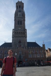 Justin in front of the Belfry of Bruges
